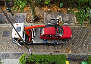 Paris, France, Tow Truck Towing illegally Parked Car on Street, high Angle