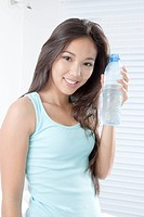Young woman holding bottled water