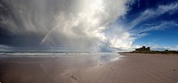 clouds reflected in the shallow water on a beach, northumberland england