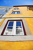 Reflection of Pantheon in a typical Lisbon facade, Portugal