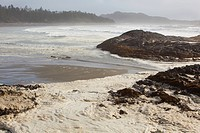 foam forms on the surface of the water at chesterman´s beach near tofino, british columbia canada