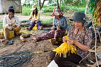 Cambodia, Kampot Province, Tonsay Island Rabbits Island, making straps for cultivation of algae