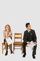 Two people waiting for interview