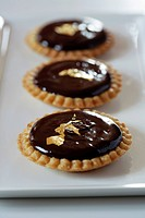 Chocolate and gold leaf mini tartlets