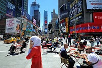 United States, New York City, Manhattan, Midtown, Times Square, veiled woman phoning