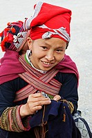 Red Dao woman doing embroidary, Sapa, Vietnam