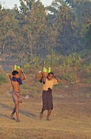 Myanmar Burma, Rakhine State Arakan, Mrauk U, men of Rakhine ethnic group or Arakanese carrying baskets fill with gourds