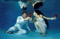 Bride and groom, underwater wedding in a pool