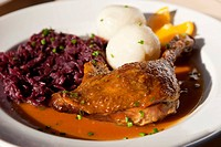 Duck leg with red cabbage and potato dumplings