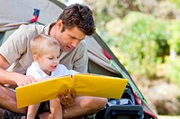 Father and son read together
