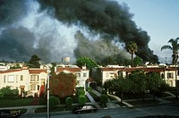 A fire in a residential neighborhood near Pico Boulevard and Fairfax during the 1992 Los Angeles riots.