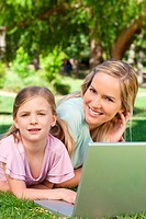 Close up of a mother and daughter with a laptop