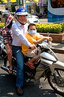 Vietnamese family ride a motorbike in Ho Chi Minh City, Vietnam.