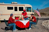 Family enjoying a 4th of July picnic alongside their RV. Tucson, Arizona.