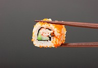 Sushi with chopsticks isolated over gray background
