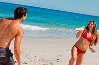 Couple having fun with beach racket