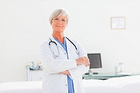 Doctor with arms folded in her office