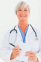 Smiling doctor pointing at prescription pad