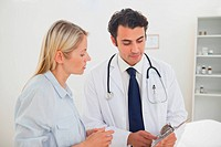 Doctor talking with patient