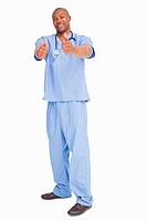 Smiling doctor in scrubs giving his approval