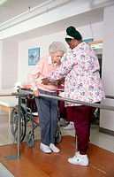 Physical therapist working with elderly patient.