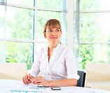 business woman in office working with papers