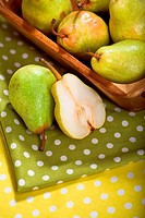 Pears in a basket on a table