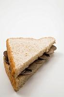 US twenty-five cent coins on sandwich half