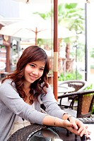 She was smiling. Brown hair woman smiling. The Restaurant