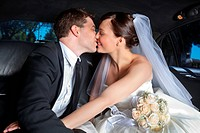 Newlywed couple kissing each other