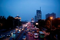 the street on the modern building background in city china. night