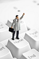 Businessman figurine on a computer keyboard
