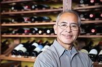 Portrait of man in wine cellar