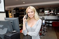 Hostess talking on phone in restaurant