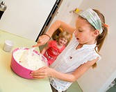 Girl mixing in bowl in kitchen