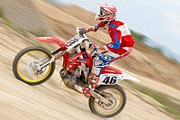 Motocross rider on a race track