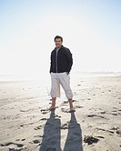 Full view portrait of man standing on beach