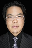 Close up of Asian businessman with eyeglasses