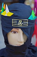 A mannequin head dressed up like a ninja