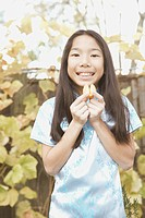 Young Asian girl holding a fortune cookie
