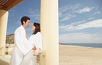 Couple hugging outdoors at a beach resort