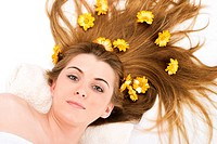 Portrait of beautiful spa woman with flower in hair.