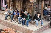 Men resting and drinking chai at Bhimeleshvara Temple in Durbar Square - Kathmandu, Bagmati Zone, Kathmandu Valley, Nepal