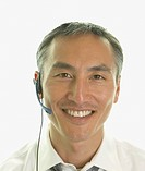 Close up of Asian businessman with headset