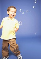 Studio shot of young boy with bubbles