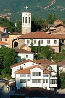 traditional house and belltower of Church St. Bogorodica Perivlepta in old Ohrid, Republic of Macedonia