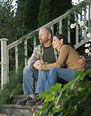 Couple hugging on porch steps