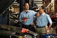Multi_ethnic male auto mechanics in shop