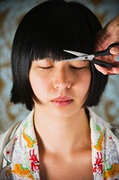 Asian woman having bangs trimmed