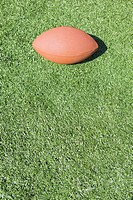 Detail of football on artificial turf field, concept